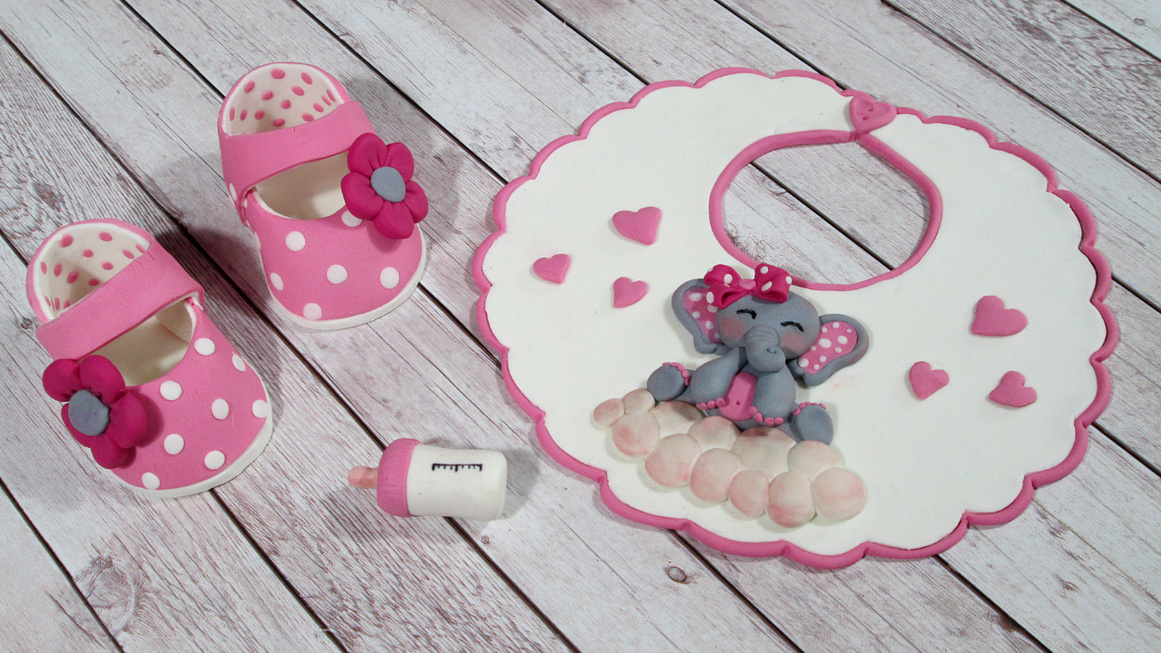 Bib, Baby Bottle, and Little Girl Baby Shoes with Flowers out of fondant